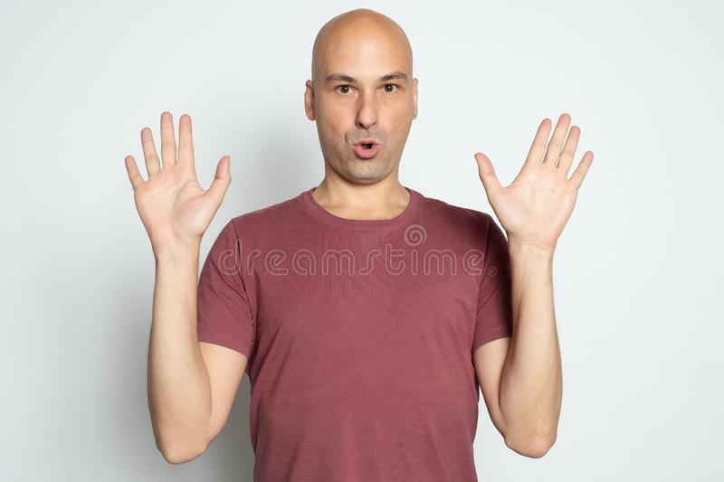 Bald man raised his arms up stock photography