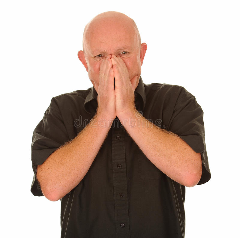 Bald man sneezing stock photo