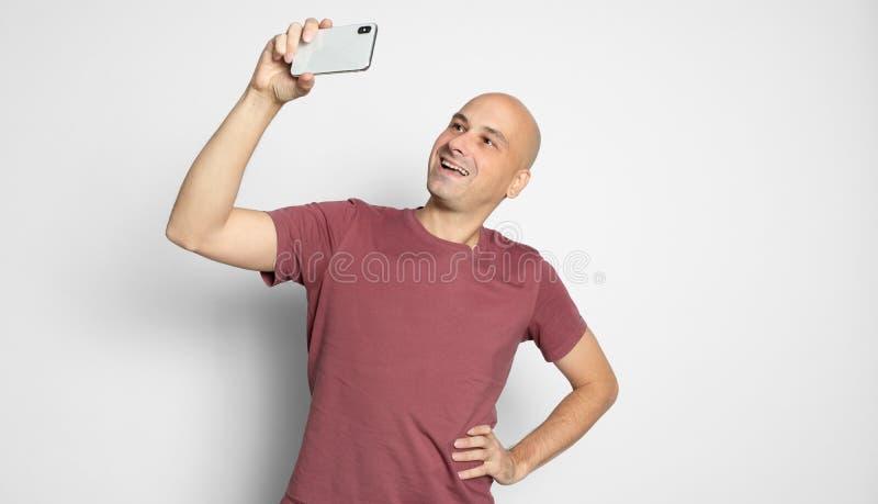 Bald man taking selfie royalty free stock photo