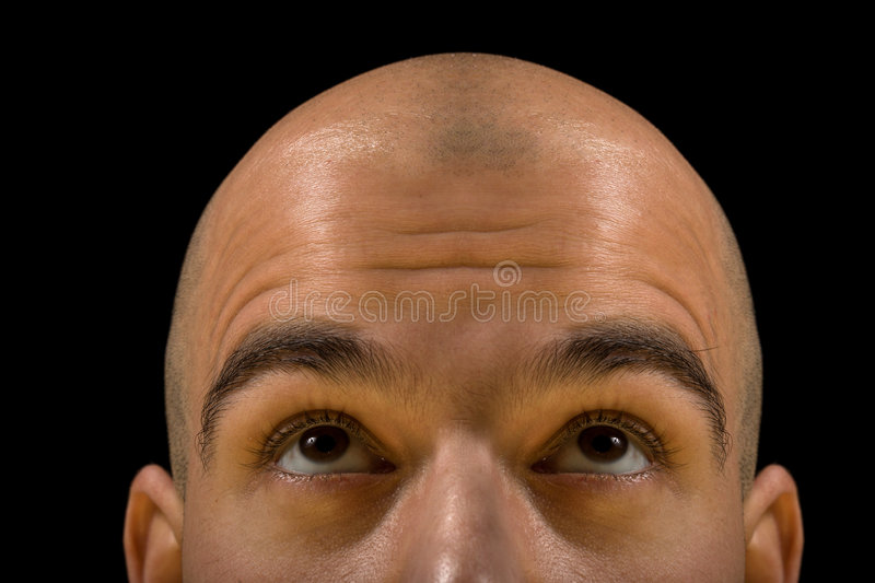 Bald man thinking. Bald man head looking up thinking, with focus on eyes