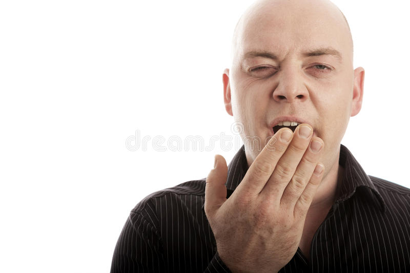 Bald man is tired and yawn royalty free stock photos