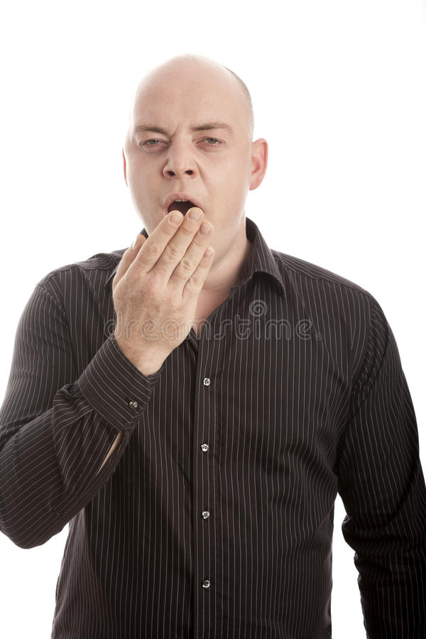 Bald man is tired and yawn royalty free stock photo
