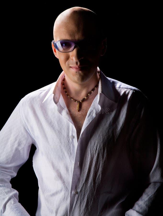 Bald man in a white shirt stock photo