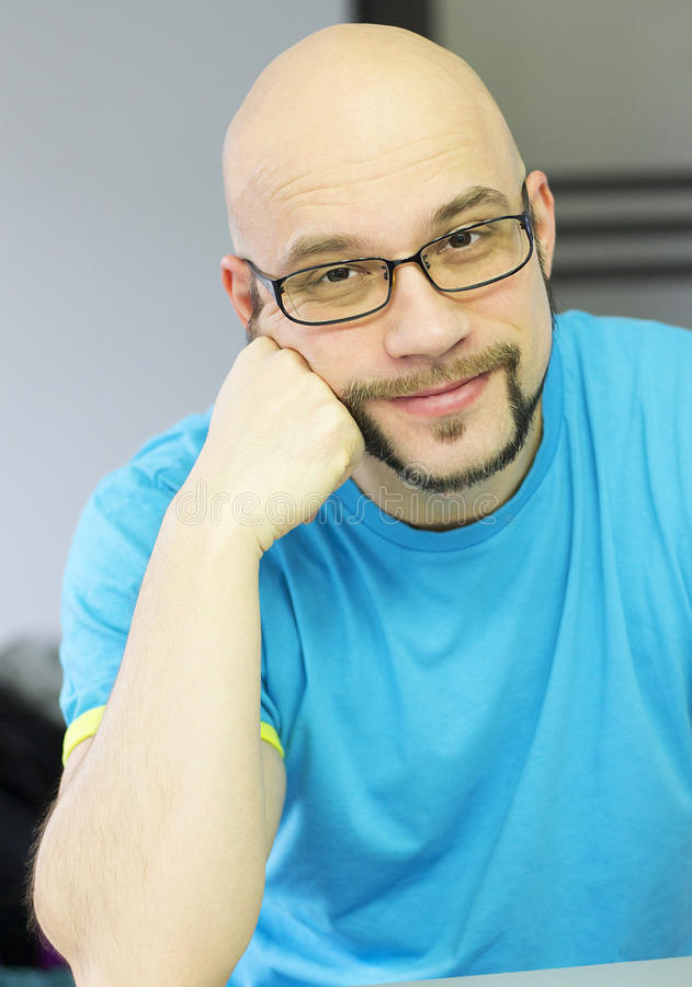 Bald men are the kindest. Kind bald man with stylish beard and glasses smiling kindly stock images
