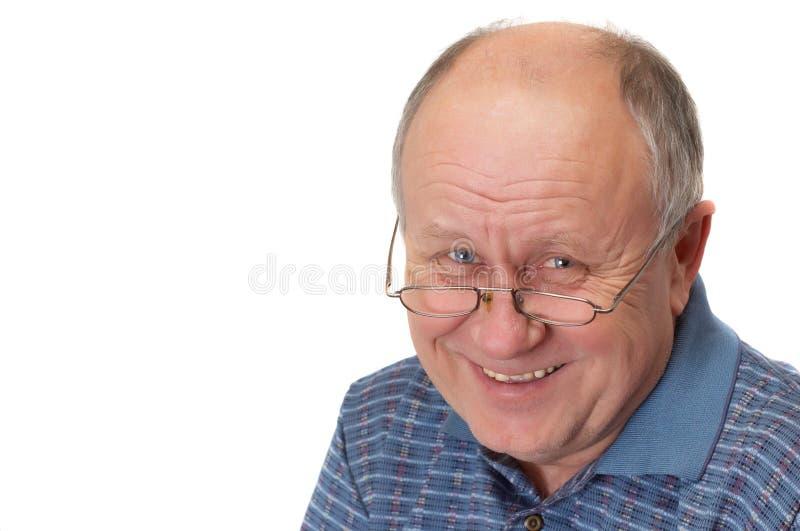 Bald senior man laughing royalty free stock images