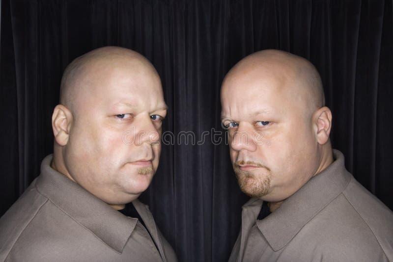 Bald twin men. stock photo
