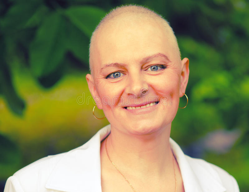 Bald woman - cancer survivor. Happy cancer survivor after successful chemotherapy royalty free stock photo