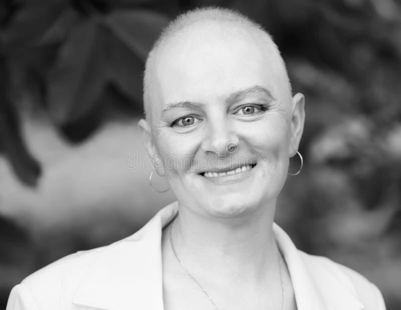 Bald woman - cancer survivor. Happy cancer survivor after successful chemotherapy stock photo