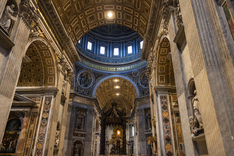 Baldachin and apse with St. Peter`s Cathedra. VATICAN, ITALY - NOVEMBER 2, 2016: baldachin Bernini`s baldacchino over the Papal Altar, apse with St. Peter`s royalty free stock photos