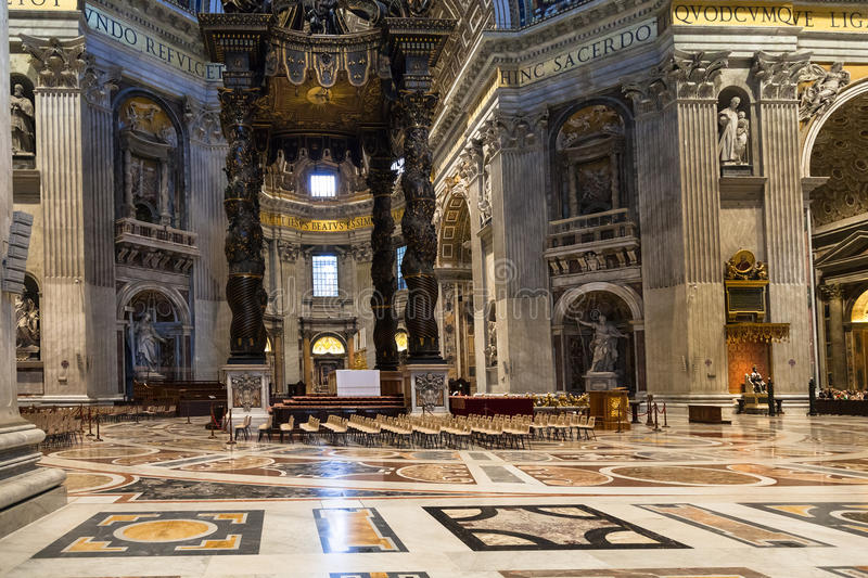 Baldachin over Altar in nave Basilica of St Peter. VATICAN, ITALY - NOVEMBER 2, 2016: baldachin Bernini`s baldacchino over the Papal Altar, designed by Gian royalty free stock images