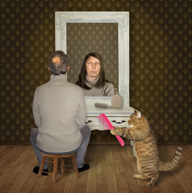Man and his cat with a comb royalty free stock photography