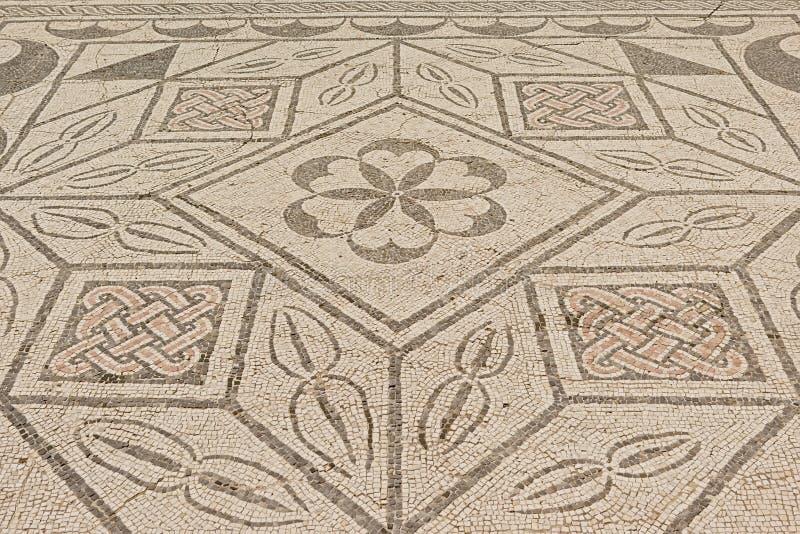 Baldosas romanas antiguas adornadas, detalle de ruinas de Italica, ciudad romana en la provincia de Hispania Baetica fotografía de archivo libre de regalías