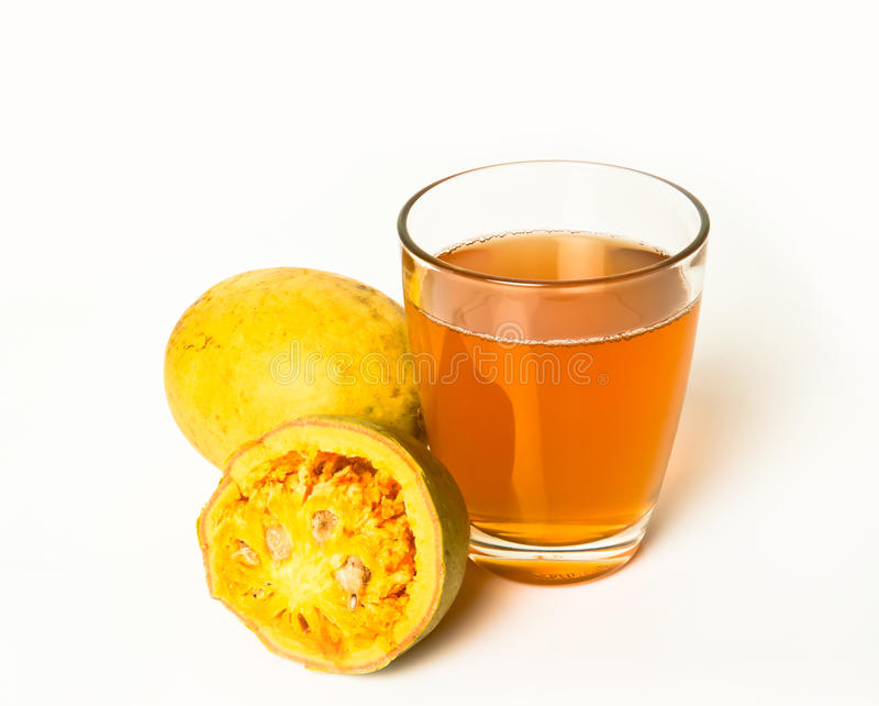 Bale Fruit Juice. Bale fruit is tropical fruit with hard exterior cover. The fruit has medicinal value for digestive system. Extensively consumed in rural India royalty free stock photos