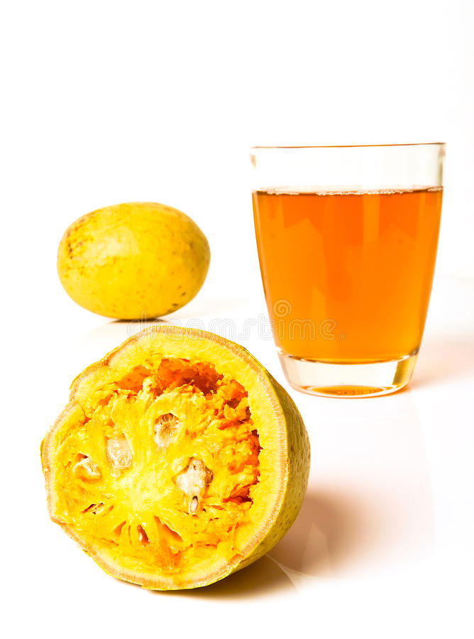 Bale Fruit Juice. Bale fruit is tropical fruit with hard exterior cover. The fruit has medicinal value for digestive system. Extensively consumed in rural India stock images