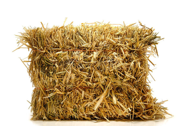Bale of Natural Farming Straw Hay over White stock images