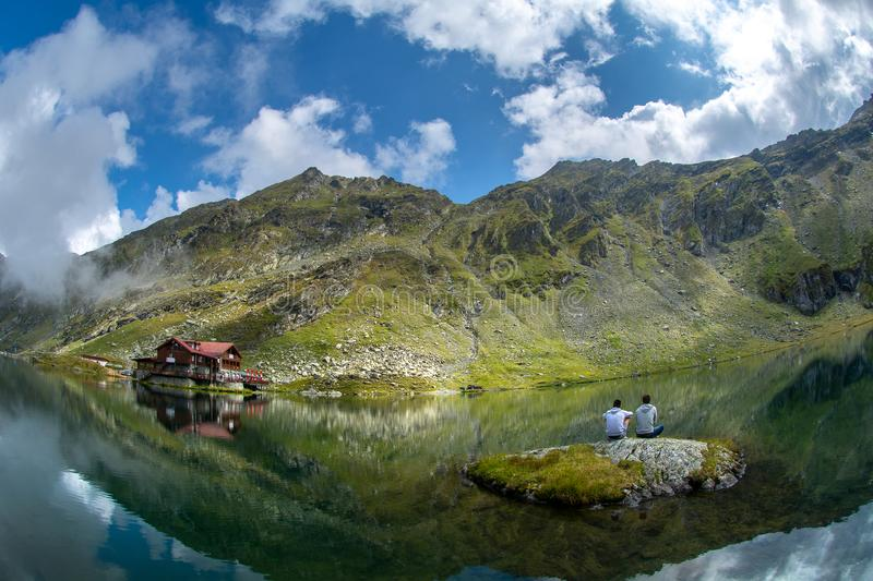 Balea glacier lake, Transfagarasan road in Romania Carpathian Fagaras mountains. Balea glacier lake and mountain cabin , Transfagarasan road in Romania royalty free stock image