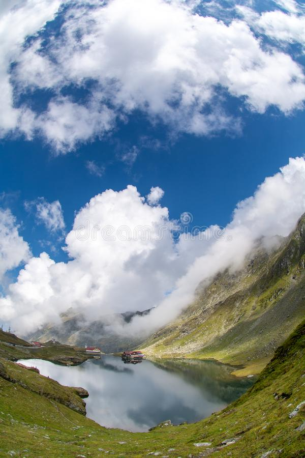 Balea glacier lake, Transfagarasan road in Romania Carpathian Fagaras mountains. Balea glacier lake and mountain cabin , Transfagarasan road in Romania royalty free stock photos