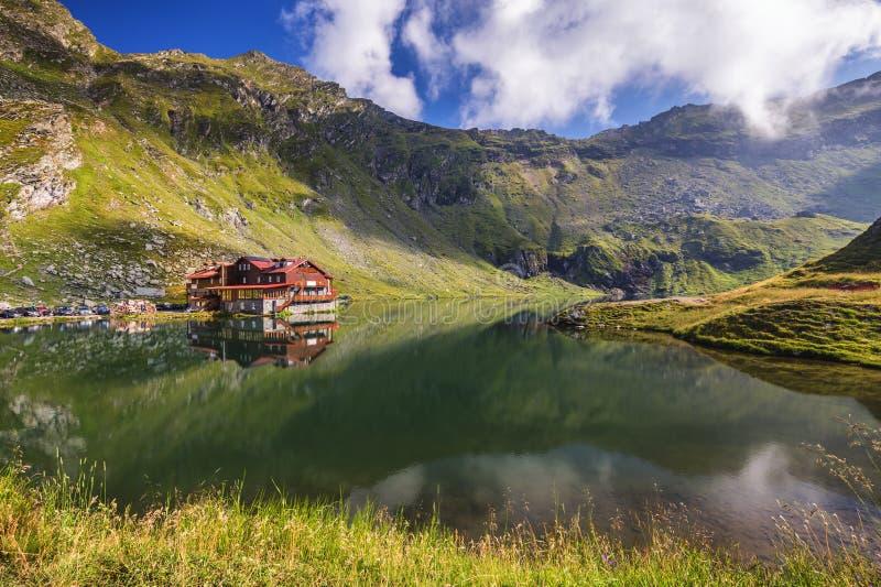 Balea glacier lake near the Transfagarasan road, panoramic view. royalty free stock images