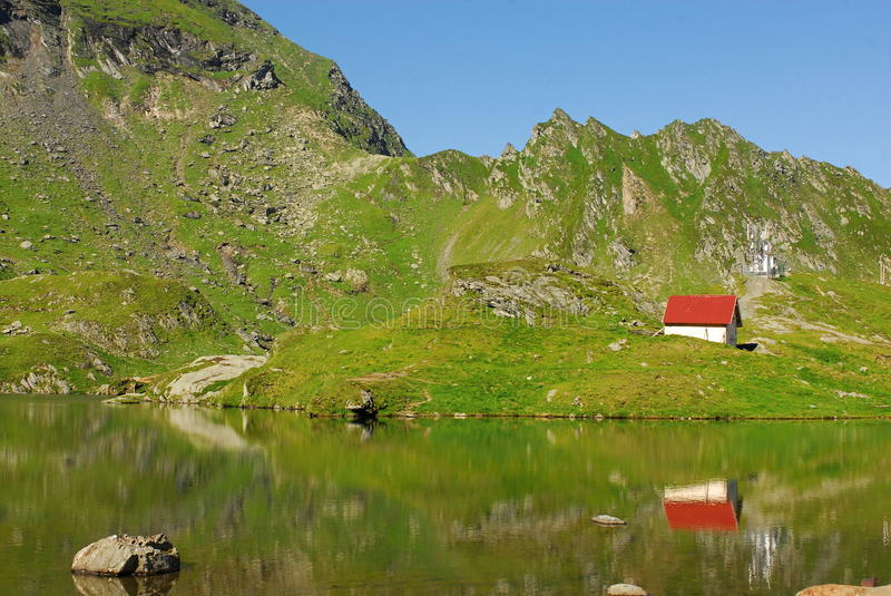 Balea lac. The Bâlea Lake is a glacier lake situated at 2,034 m of altitude in the Făgăraş Mountains, in central Romania, in Sibiu County. It is stock images
