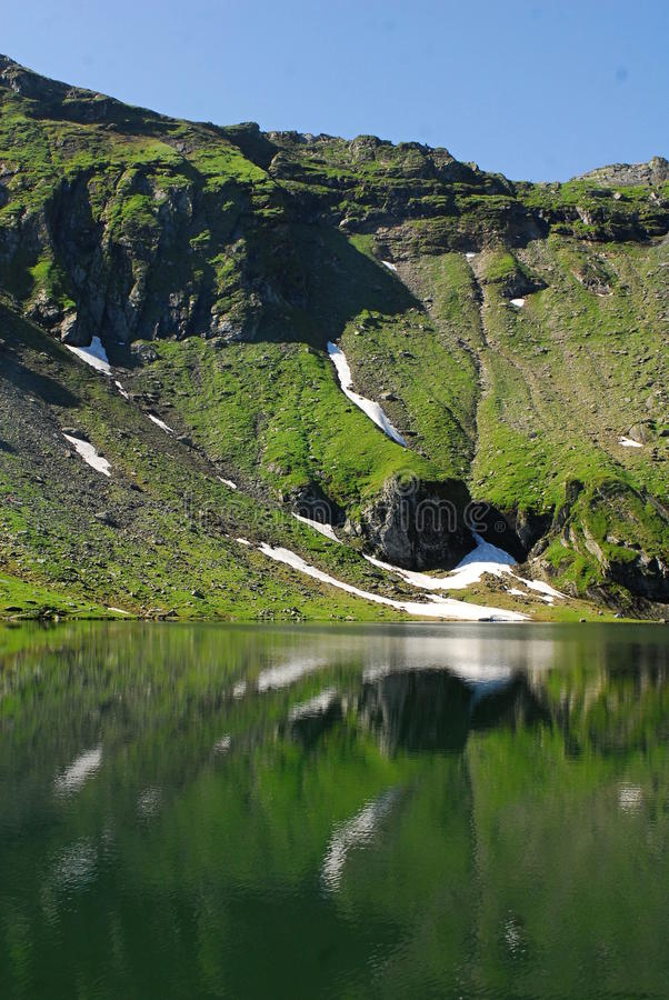 Balea lac. The Bâlea Lake is a glacier lake situated at 2,034 m of altitude in the Făgăraş Mountains, in central Romania, in Sibiu County. It is royalty free stock photo