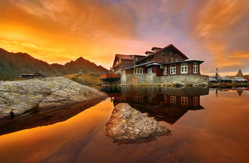 Balea Lac Chalet at Sunset. Balea Lac Lake Chalet, Sunset Landscape in Fagaras Mountains, Romania stock image