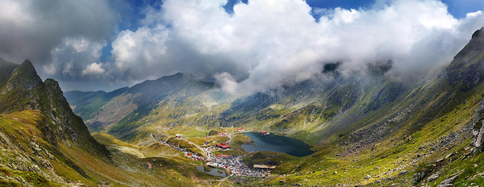 Balea lac from Fagaras mountains. Scenic view of Balea Lac from Fagaras mountains stock photos