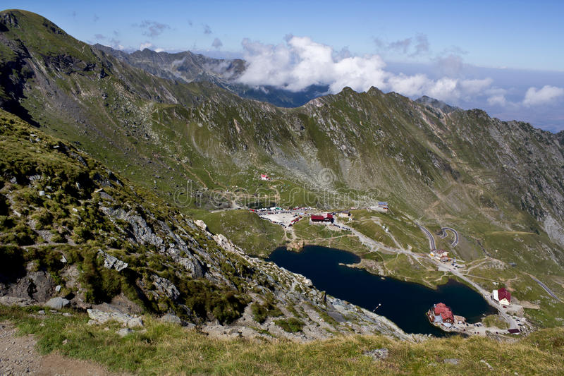 Balea Lake. Balea glacial lake and road Transfagarasan, Romania stock photo