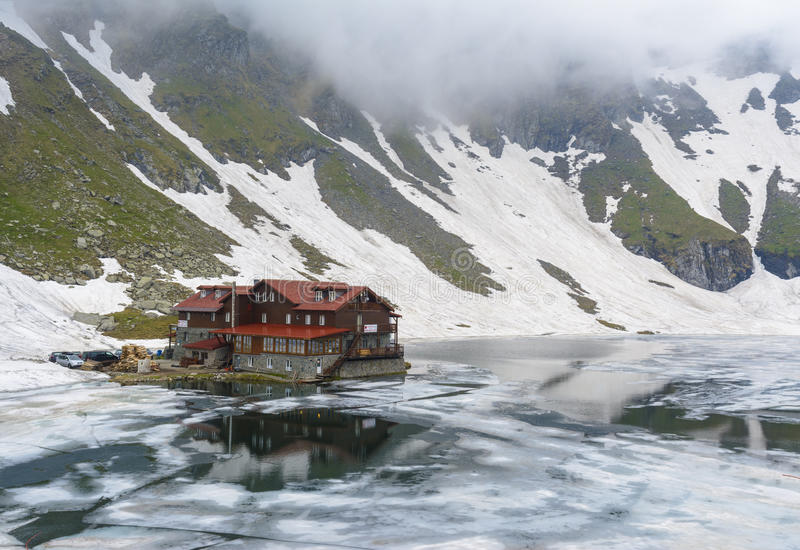 Balea lake, Transfagarasan, Romania. Balea Lake Chalet on glacier lake. Balea Lake is a glacier lake situated at 2, 034 m of altitude in the Fagaras Mountains royalty free stock image