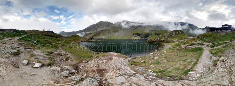 Balea Lake in the Fagaras Mountains. Balea Lac panorama in the Fagaras Mountains stock photo