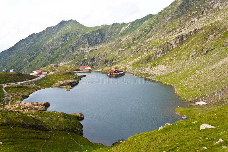 Balea lake the glacial lake from Romania. Landscape from Balea Lake, Fagaras Mountains, Romania in the summer stock photos