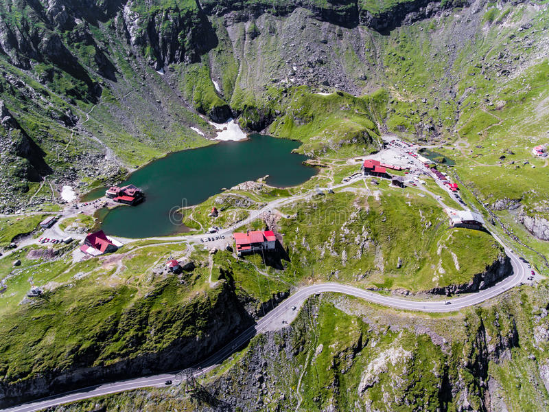 Balea Lake on Transfagarasan near Sibiu Romania. Aerial view from above royalty free stock photography