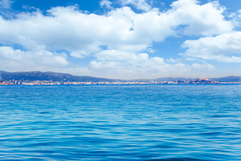 Balearic Ibiza island general view from open sea. In Mediterranean spain royalty free stock image