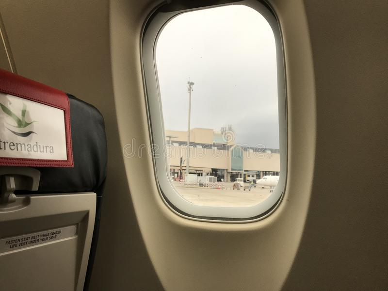 Into the aircraft. At airport stock photos