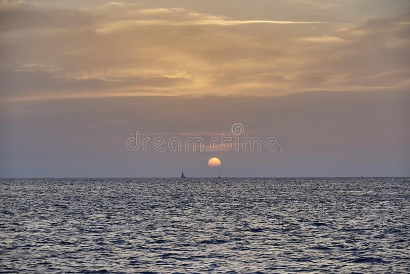 Balearic sunset from La Savina in Formentera with Es Vedra of Ibiza in background royalty free stock photos