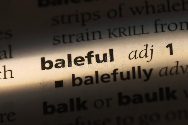 Baleful. Word in a dictionary.  concept stock images