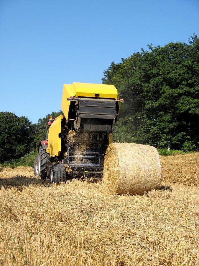 Free Baler Discharging Round Bale Stock Images - 8076094