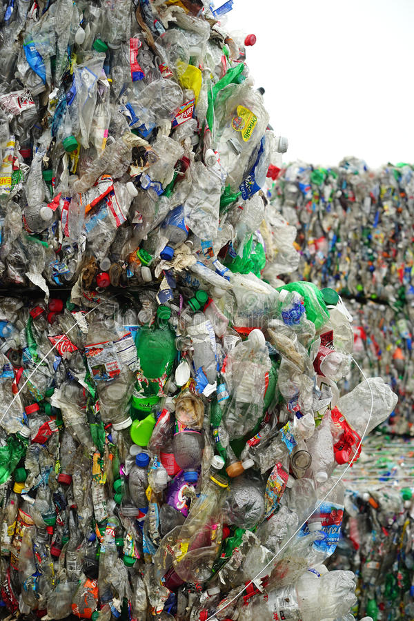 Bales of drink containers at recycling center. Modern recycling facilities flatten and bale plastic drink containers of all sizes prior to shipping royalty free stock photos