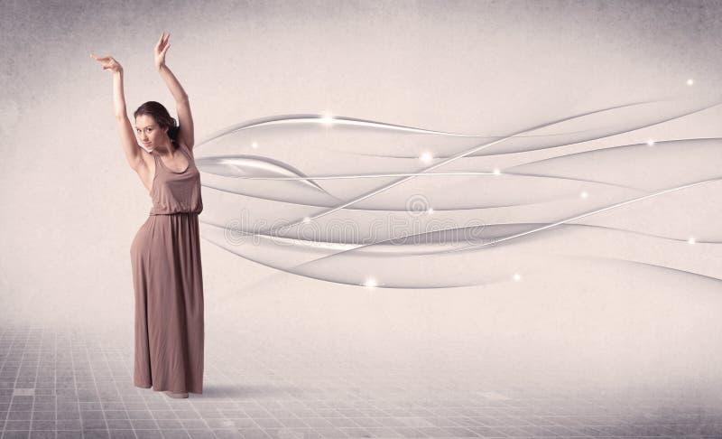 Balettdansör som utför modern dans med abstrakta linjer royaltyfri foto
