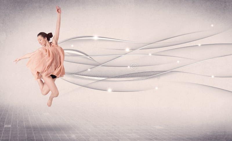 Balettdansör som utför modern dans med abstrakta linjer arkivbild