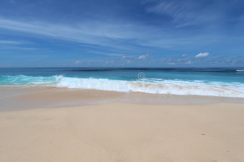 Bali beach with whate sand and blue waves. In Bukit stock photo