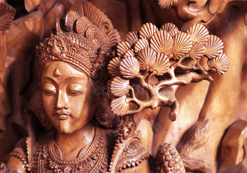 Bali Carving. Bali, carving, wood, horizontal, brown, woman, face, tree, eye, noise, mouth royalty free stock photo