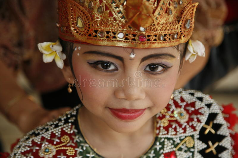Bali dancer. JAKARTA, INDONESIA - JULY 23, 2006: Young Balinese dancer is posing after performing her traditional Balinese dance on July 23, 2006 in Jakarta royalty free stock photo