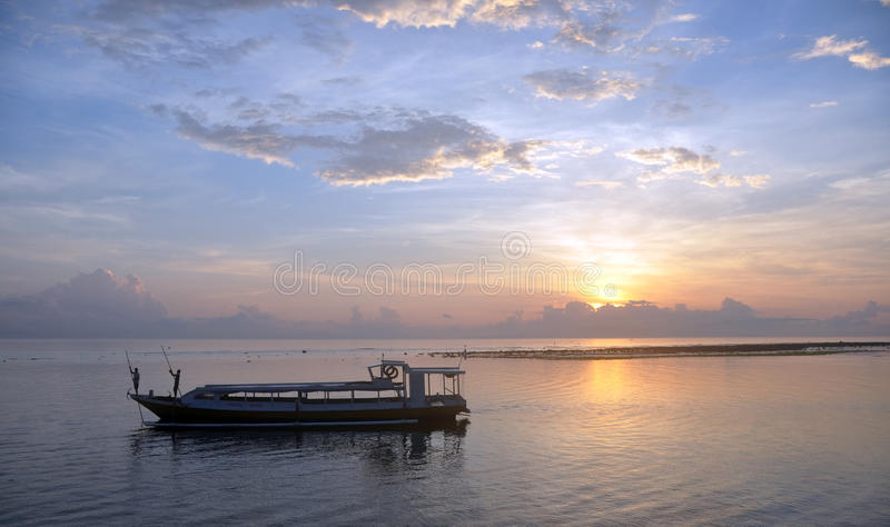Bali Fishermen Preparing Their Boat at Dawn royalty free stock image