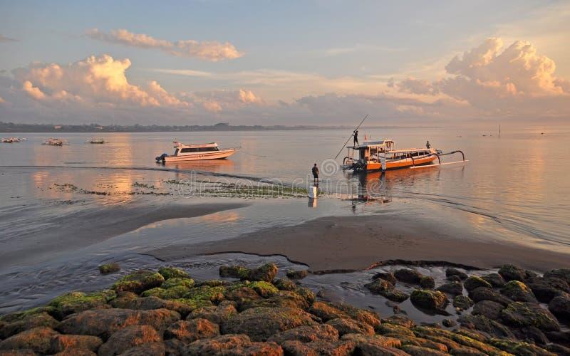 Bali Fishermen Preparing Their Boat at Dawn at Sanur Beach. royalty free stock images