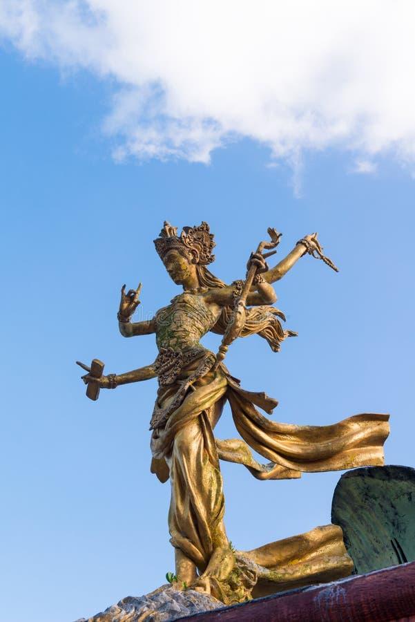 Bali goddes of dance statue. Six handed Bali goddes of dance statue against blue sky royalty free stock photos