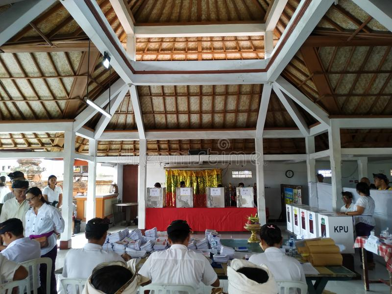 BALI/INDONESIA-APRIL 17 2019: Balinese people vote for the president and parliament 2019. They go to the polling stations using stock photography