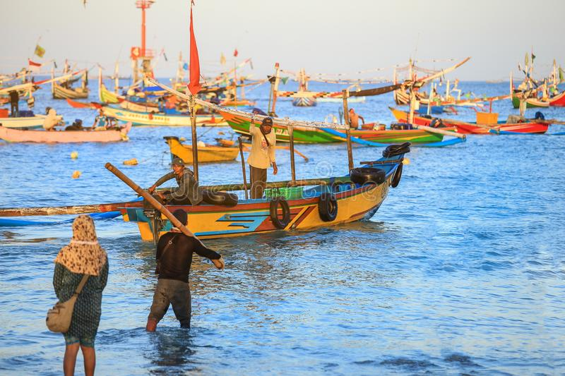 Balinese fishing boat at port in Jimbaran beach, Bali stock photo