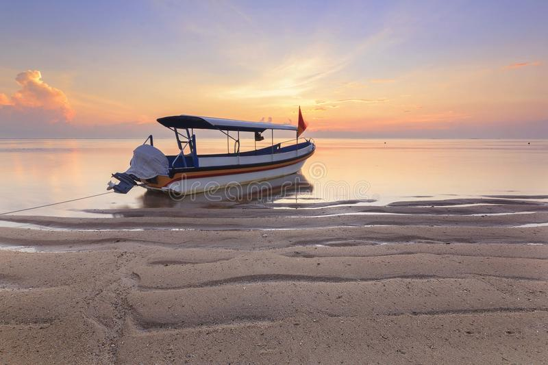 Bali, Indonesia. Fishing boats populate the shoreline at the Sanur Beach stock photography