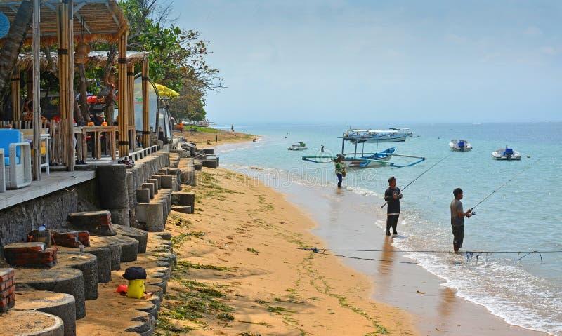 Fishermen on Sanur beach, Bali Indonesia. stock photography