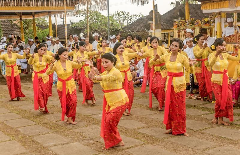 Beautiful indonesian people group in colorful sarongs - traditional Balinese style ethnic dancer costumes at Bali Arts and royalty free stock photos